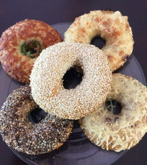 Pictured clockwise from top left are jalapeño pepper jack, French onion Swiss, sautéed mushroom Swiss, everything, and sesame bagels which will be available at Black Market Bagels, 337 E. Main St.