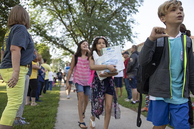 Students enter Martin Luther King Elementary School on the first day of school in 2018.