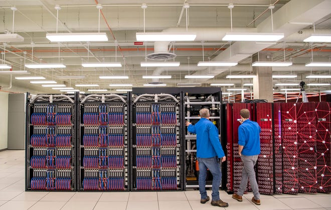 Kevin Hutchinson, left, and Cole Harvey work on setting up Big Red 200 in January 2020. The supercomputer at Indiana University will play a key role in research at the new Luddy Center for Artificial Intelligence.