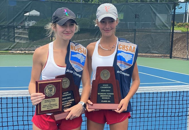 Hendersonville's Mccollough Perry, left, poses with her sister, Eliza, after they won the 2-A state doubles title. Mccollough was also named the MVP of the 2-A state tournament.