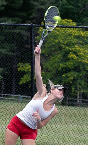 Hendersonville High's McCollough Perry serves against Brevard's Esther Monahan in a match earlier this year at Jackson Park.