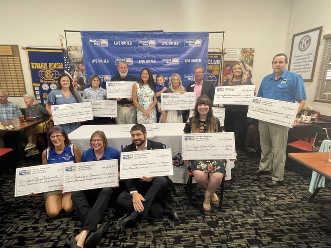 Check recipients at Thursday morning's United Way of Onslow's Annual Giving Campaign.