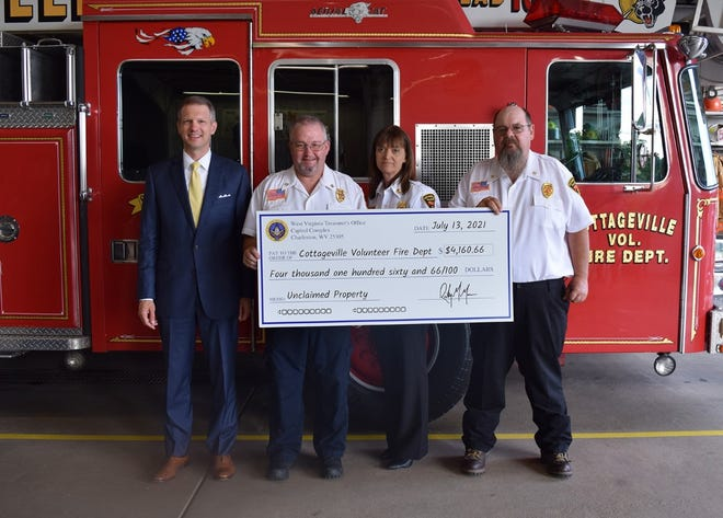 State Treasurer Riley Moore presents an unclaimed property check to Cottageville VFD Chief Michael Morrison, Assistant Chief Cindy Morrison and Deputy Chief Gregory Jewell.