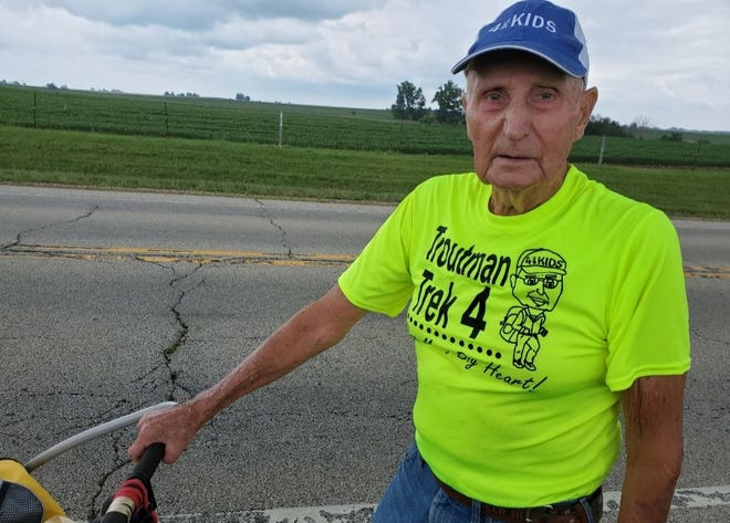 This July photo shows Dean Troutman between Chenoa and Fairbury on the fifth day of his 3,500-mile walking trek to raise money for St. Jude Children's Hospital. The 90-year-Princeville man was sidelined this week by medical woes, but he hopes volunteers can continue the walk and its fundraising.