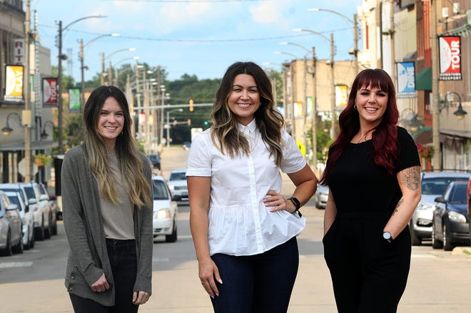 Mady Haight, left, Ashley Jackson, and Michelle Harrison are three new female small business entrepreneurs joining the majority of female-owned businesses in downtown Freeport. The three women, seen here on Stephenson Street on Tuesday, July 13, 2021, plan to open their businesses in the next couple of months.