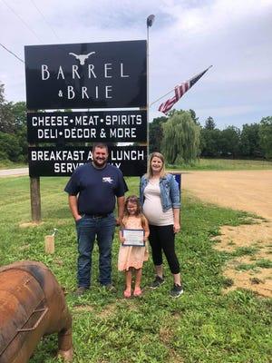 Lena American Legion junior member Liesel Jones recently presented a certificateto Barrel & Brie for displaying the American flag on a regular basis.Pictured, from left:Scott Wanek, Liesl Jones and Kim Confer.