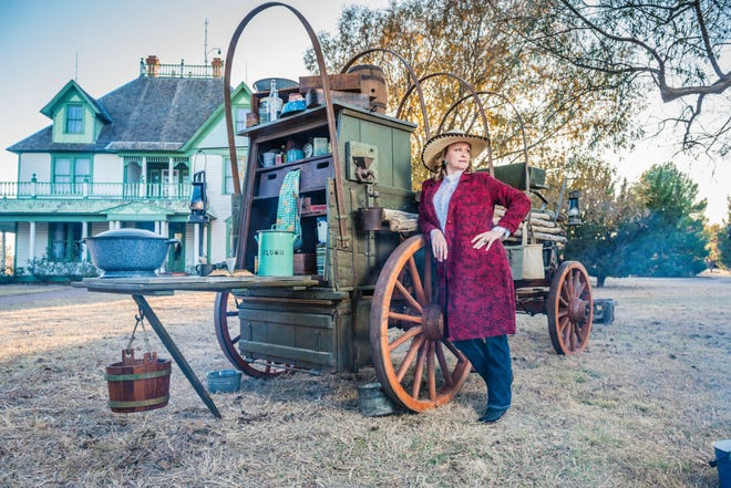 Monika Hightower and her authentic 1890's HX chuck wagon will be in the National Ranching Heritage Center historic park this Saturday to greet visitors from 10 a.m. to 1 p.m. In the background is the 1909 Barton House moved to the center in 1975 from the TL Ranch 30 miles north of Lubbock.