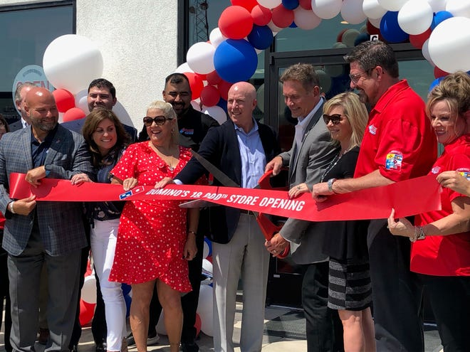La Junta Domino's Pizza Franchisee Brian Bailey did the ribbon cutting Thursday to commemorate his La Junta store being the 18,000th Domino's Pizza to open worldwide.