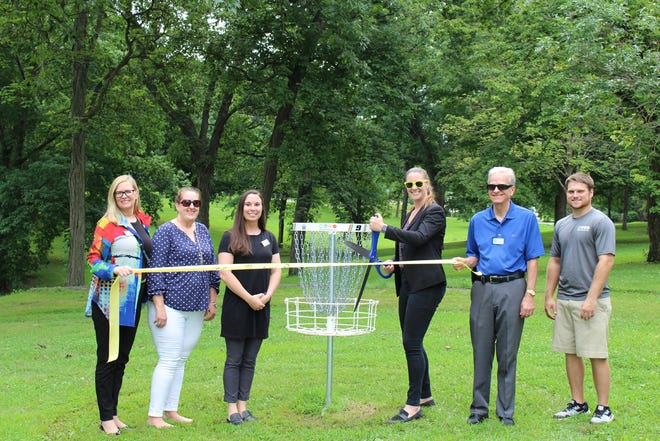 The Ambassador Committee of the Macomb Area Chamber of Commerce held a ribbon cutting on June 14 for the Macomb Park District, as they upgraded the baskets on the 12-hole Everwood disc course golf that shares locations in neighboring Glenwood and Everly Parks in Macomb. The enhancements are just one of many upgrades that the park district has made to enhance the opportunity for the community to get out and play. For more information, visit macombareaparkdistrict.com.