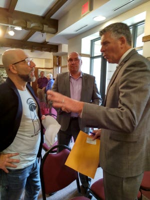 Congressman Darin LaHood (right) speaks with Convention Bureau Director Jock Hedblade (left) while Citizens Bank President Todd Lester looks on.