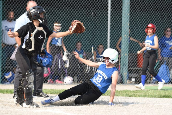 Makenze Doody of Dundee slide home with a run ahead of a throw to Summerfield catcher Savanna Novencido Wednesday.