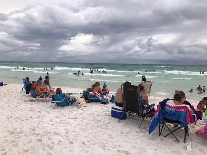 Beachgoers enjoy a recent afternoon at the Miramar Regional Beach access, a public section of beach in Walton County. On Tuesday, county commissioners approved a tighter process for county acquisition of property including beaches.