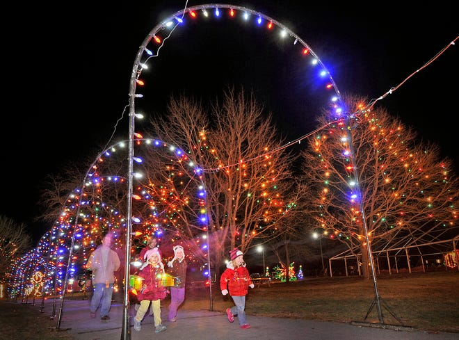 Visitors enjoy the lights as they enter Edaville in 2012.