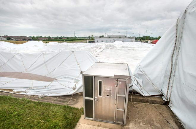 A doorway stands alone surrounded by the deflated Avanti's Dome, 3401 Griffin Ave., Pekin. High winds from a storm last month damaged the structure and deflated the dome.