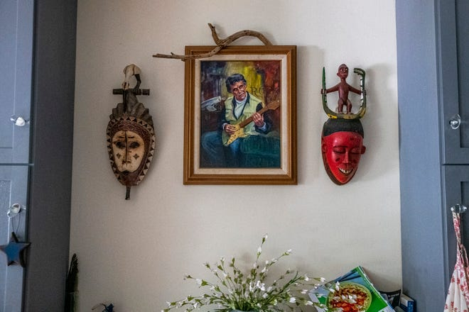 """A portrait of Cherie Herne's father, Bobby Herne, hangs on the wall of her home on Thursday, July 15, 2021, in York, Maine. Every night, Herne says goodnight to the painting of her father, who was a notable guitarist in New England,  she said. Playing from 1955 to 1957, the All-Stars group featured Herne and Fred Dame, and a group of Black musicians from Detroit stationed at Pease Air Force Base: John and Alan Ramsey, Nelson Cantare and Leonard Ramsey, according to earlier reporting by Seacoastonline. At one point, the All-Stars made it to the Billboard 100 with """"Right after School"""" and """"Love is the Game."""""""