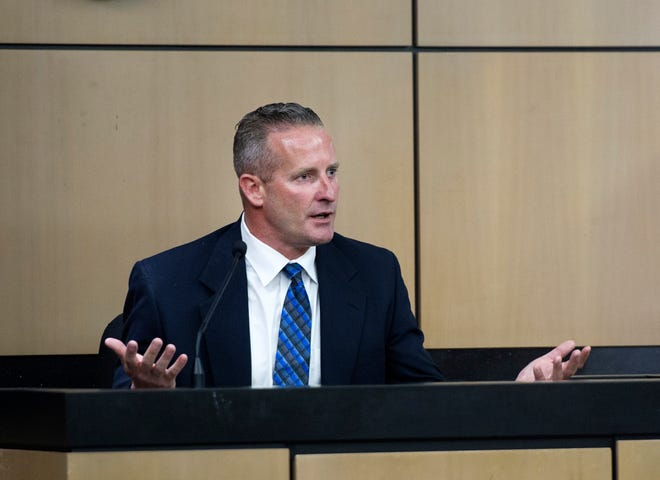 """Palm Beach County Sheriff's deputy Jason Nebergall testifies at the Palm Beach County Courthouse July 12, 2018. """"She leaned into my personal space,"""" Jason Nebergall said. """"I pushed her back."""" Nebergall is charged with sexual battery stemming from a disturbance call that he responded to in 2016. (Meghan McCarthy / Daily News)"""