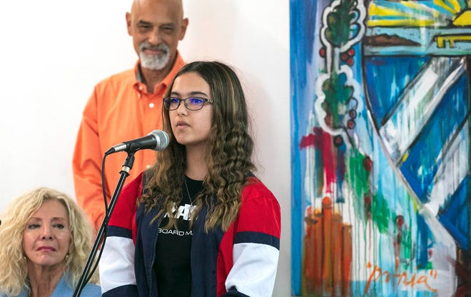 Sofia Ayala, 15, speaks Thursday at a news conference about unrest in Cuba. At left are Palm Beach County Commissioner Maria Sachs and Rolando Chang Barrero, owner of the Box Gallery.