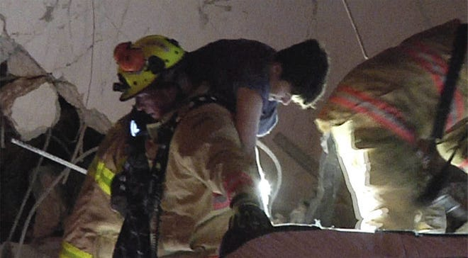 Jonah Handler is rescued soon after the collapse of the Champlain Towers South condo in Surfside on June 24.