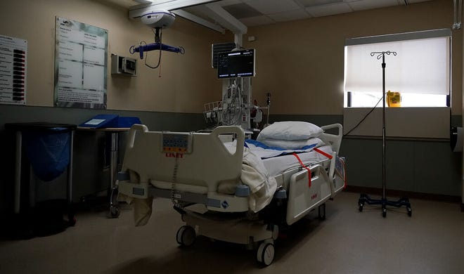 An empty ICU bed waits for a patient to arrive on Sunday, Nov. 23, at SSM Health St. Joseph Hospital in Lake Saint Louis, Mo. St. Joseph has had to expand their COVID-19 unit to other branches of the hospital since their ICU hit its capacity.
