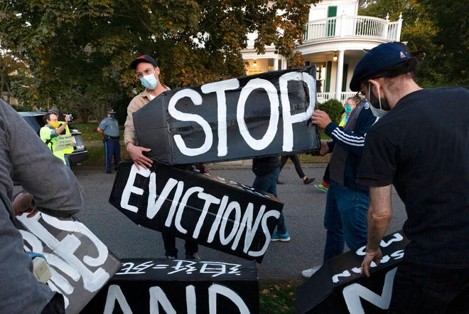 FILE - In this Oct. 14, 2020, file photo, housing activists erect a sign in Swampscott, Mass. A federal freeze on most evictions is set to expire soon. The moratorium, put in place by the Centers for Disease Control and Prevention in September, was the only tool keeping millions of tenants in their homes. AP Photo/Michael Dwyer, File