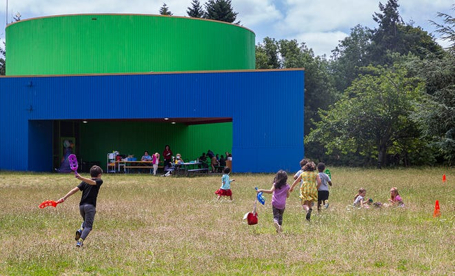 Kids rush around and play or eat in the sun during lunch and recess at the Eugene Science Center on July 8. The center has been facing issues with reopening since the lockdown in 2020. While the museum is still closed to the public, childcare, tutoring and summer camps have kept them busy through the year.