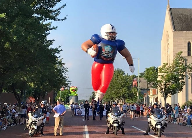 The Canton Repository Grand Parade is one of the signature events of the Pro Football Hall of Fame Enshrinement Festival.