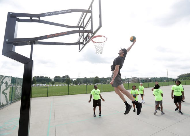 GlenOak standout basketball player and NBA veteran Kosta Koufos stopped by the courts named after himself at GlenOak High School to put on a show for the kids in the Books and Buckets summer program.