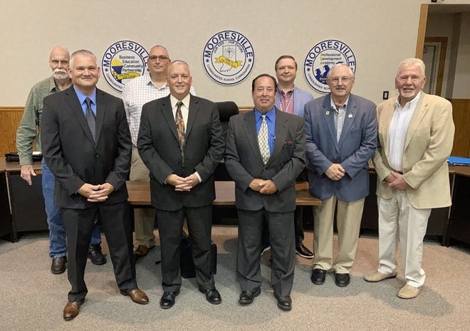 Members of the school board pictured with the three officers. From left to right: Sean Paris, Mark Harris, and Billy Snyder.
