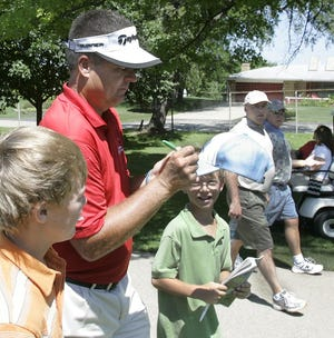 Kenny Perry, shown signing autographs for fans in 2008, was the last big-name PGA Tour golfer to headline the Rockford Pro-Am, which turned to younger male pros and LPGA golfers in recent years but has not been held since 2019.