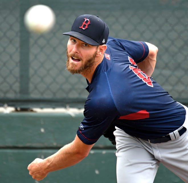 Boston Red Sox pitcher Chris Sale, 32, warms up in the bullpen before the game against the Orioles during a Florida Complex League (FCL) rookie-level of Minor League Baseball on Thursday, July 15, 2021, at Ed Smith Stadium in Sarasota, Florida.