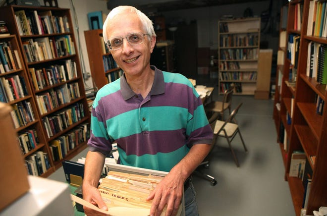 Mark Rodeghier, director of Center for UFO Studies (CUFOS), shows off files in the basement of his house in Norwood in 2013.