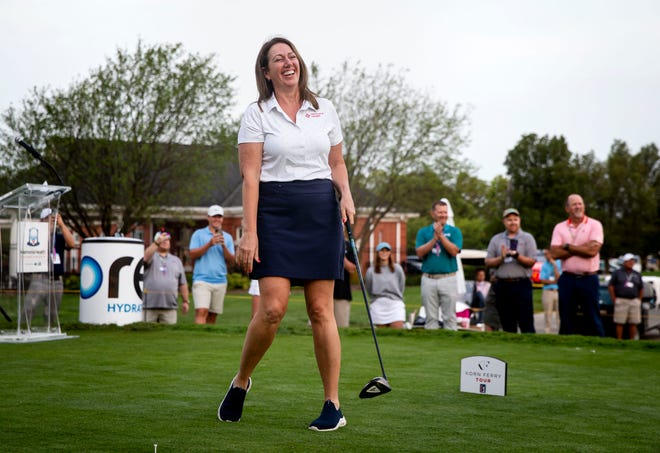 """Dr. Anna Richie reacts after her ceremonial """"first shot"""" goes a bit off target as she kicks off the Korn Ferry Tour's Memorial Health Championship presented by LRS on the No. 1 hole at Panther Creek Country Club in Springfield, Ill., Thursday, July 15, 2021. Throughout the pandemic Dr. Richie served as the clinical director of Memorial Physician Services' ExpressCare and medical director of the respiratory clinic on South Sixth Street. She, along with her two daughters, tested positive for COVID-19 but have recovered and are doing well. [Justin L. Fowler/The State Journal-Register]"""