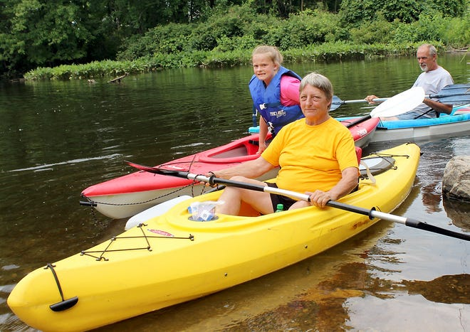 Celebrating her birthday, Vicki Cooper of Three Rivers took part in a day of kayaking July 10 on Portage River with Mendon resident Brooklyn Harvath and Dave Cooper. Cooper said the stretch from Marcellus Road to Parkville Road is a favorite route.