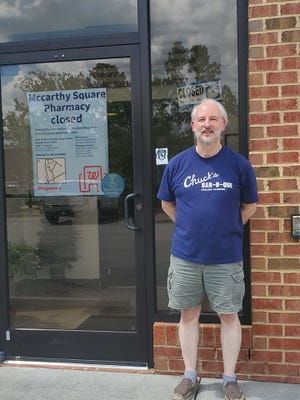 """Pictured, Owner George W. Davis III, better known to his customers as """"Dave"""", stands in front of McCarthy Square Pharmacy which closed its doors on July 7."""