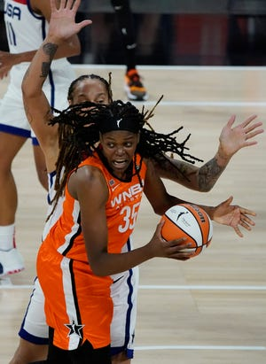 Team WNBA's Jonquel Jones drives against United States' Brittney Griner during the WNBA All-Star game in Las Vegas.