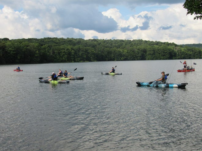 A group of first-time kayakers test their paddling skills on the Quemahoning Reservoir in Somerset County.