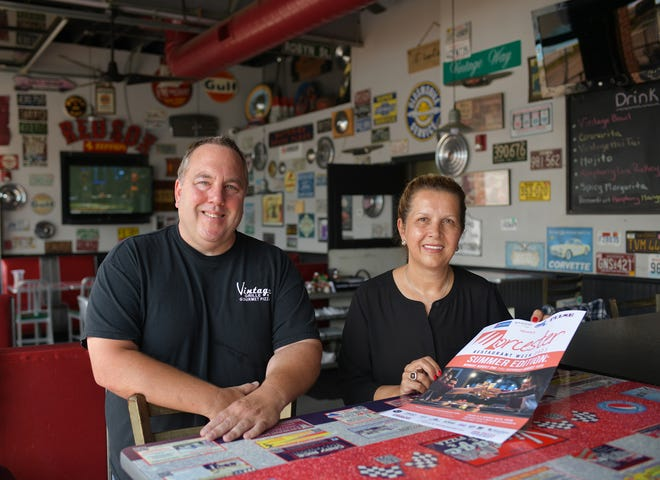WORCESTER - Vintage Grille owner Chris Stone and Nuovo owner Loreta Gjonca with Restaurant Week poster on July 15.