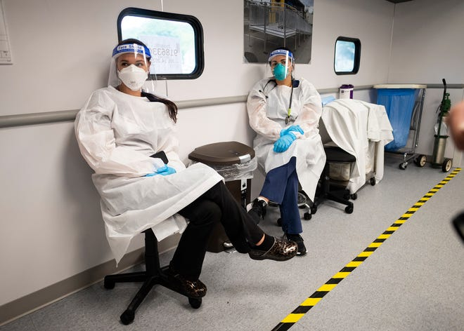 UMass Health nurses Jen LePage, left, and Carmen Porto, sit in the new mobile facility that will expand access to COVID-19 monoclonal antibody (mAb) treatments Thursday at UMass Memorial Medical Center's Hahnemann campus parking lot in Worcester.