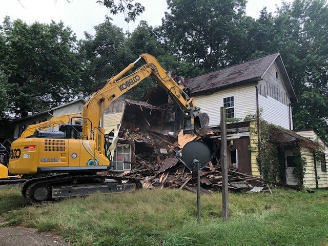 The city of New Philadelphia had a dilapidated house at 410 Second St. NE this week as part of an effort to clean up the community.