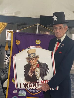 """Past District Governor Bill Willis explains the origin of the world-famous Uncle Sam """"I Want You"""" poster at a July 6 meeting of the French Lick-West Baden Lions Club. The meeting date was the anniversary of the first appearance of the image of Uncle Sam, which was July 6, 1916, during World War I on the cover of Leslie's Weekly magazine. It is a portrait of artist James Montgomery Flagg, who painted his own image to save the cost of hiring a model. His painting was so popular that it was used again in World War II recruiting efforts and has gained recognition all around the world."""