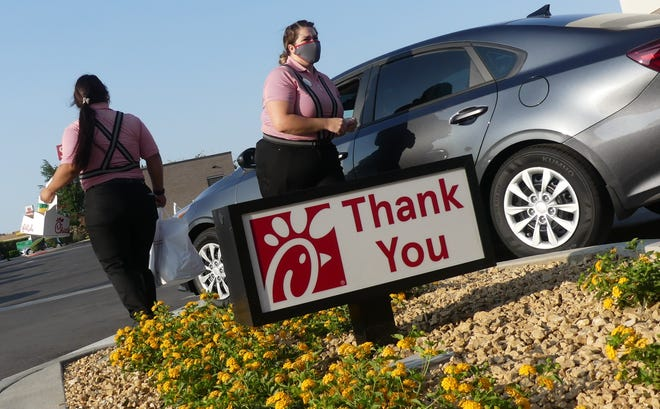 Chick-fil-A employees serve customers at the restaurant's drive-thru in Victorville on Thursday, July 15, 2021. Hundreds of patrons attended the restaurant's grand opening on Mariposa Road.