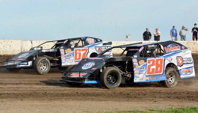 Brothers Mike (67) and Tommy Nichols (28) of Watertown battled for top honors in the Midwest modified class Wednesday night during the 11th USMTS Summer Slam at Casino Speedway. Mike edged Tommy to win the third heat and then took the 20-lap feature later in the night — his fifth feature win of the season. Tommy finished third in the feature.