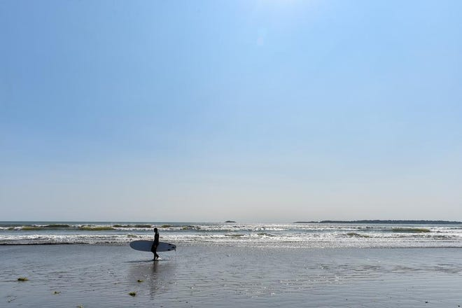 A surfer on Kings Beach in September of 2020.