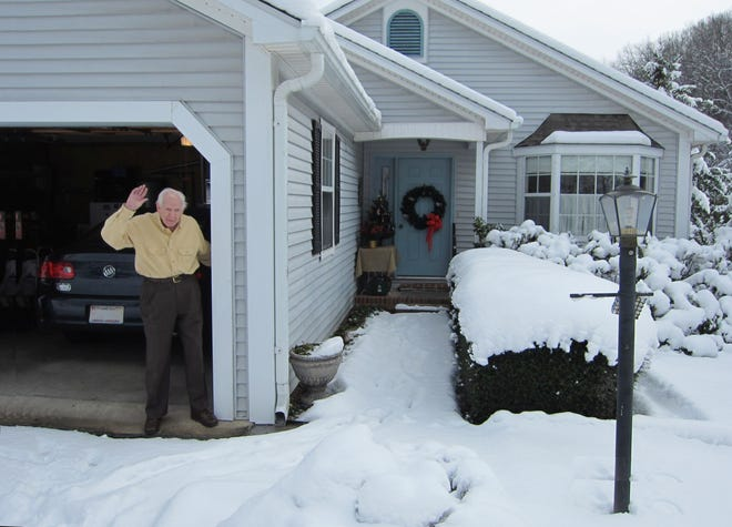 Clarence Prinkey waving from his garage outside his Brevard home during the winter of 2000. Prinkey moved from New Jersey into this home with his wife Blanche and son Kevin during the 1980s.