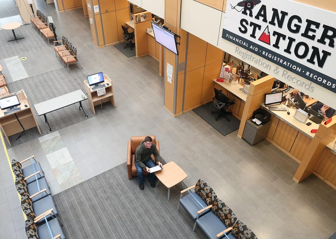 Kenneth Guyer, of Gig Harbor, signs up for classes in the student Welcome Center at Olympic College in Bremerton on Thursday. OC says it plans on offering more in-person classes during the fall quarter, which starts in September.