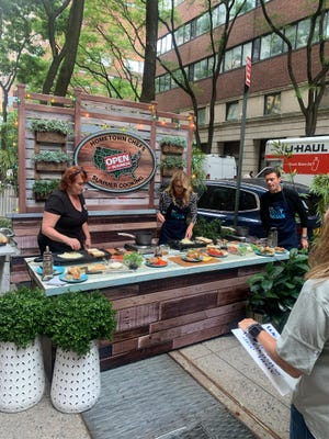 South Jersey chef Mary Hilbert, right, is shown on the set of the 'Live with Kelly and Ryan' show with hosts Kelly Ripa, center, and Ryan Seacrest. Hilbert has a food truck Mary's Mobile Diner, and appears on 'Live's Hometown Chefs Summer Cooking' series which showcases a different chef each Friday.