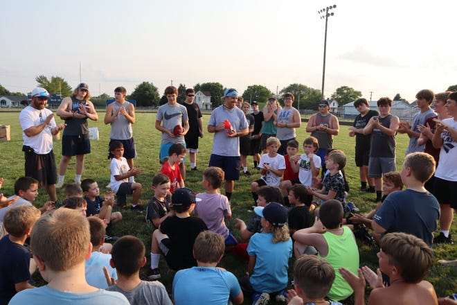 Coach Brian Grigsby speaking to campers at the conclusion of camp.