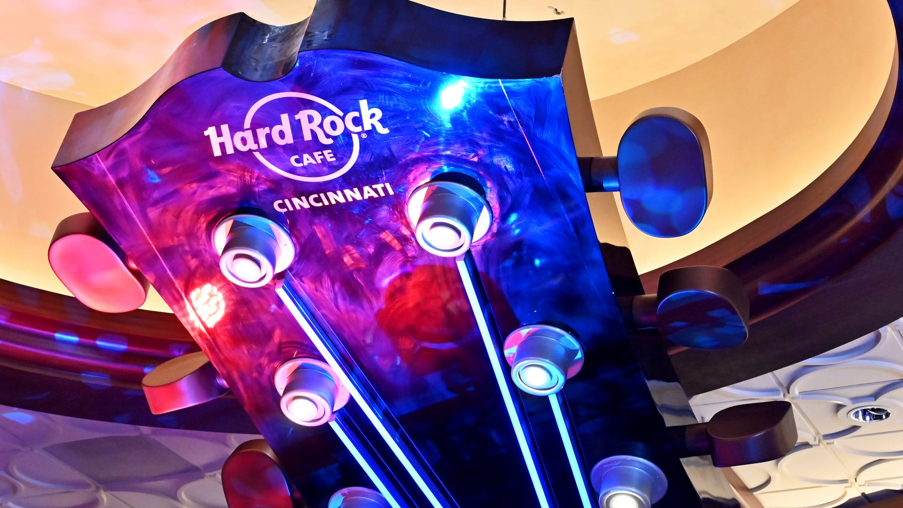 A sculpture of a guitar hangs at the front of the Hard Rock Cafe during its official opening July 15 inside the Hard Rock Casino Cincinnati.