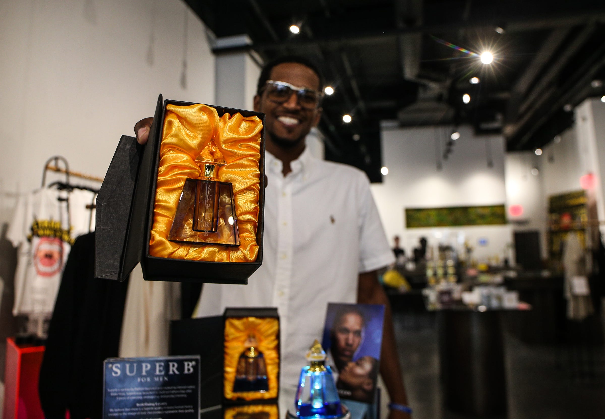 Blake Hare of Superb For Men in the Detroit is the New Black. store in Detroit on July 14, 2021. Superb is a Black owned, Detroit-based cologne that was launched in 2020 on Father's Day.