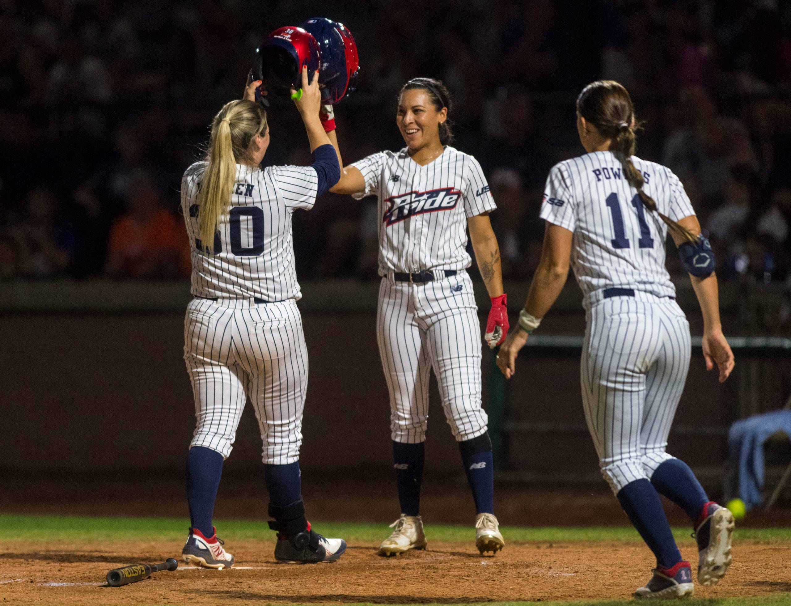 USSSA Pride's Jessie Warren (30) and USSSA Pride's Sierra Romero (32) celebrate after Warren hits a home run as the USSSA Pride takes on Team Florida in an exhibition game at Bosse Field in Evansville, Ind., Wednesday evening, July 14, 2021.